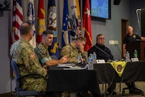 Chemical Biological Incident Response Force (CBIRF) Commander U.S. Marine Corps Col. Donald Riley speaks as part of a leadership panel during a Defense Chemical, Biological, Radiological and Nuclear (CBRN) Response Force (DRCF) leadership symposium. The symposium was held during Joint Task Force Civil Support's (JTF-CS) 20th anniversary celebration, which also included a room dedication for the late U.S. Army Maj. Gen. (ret) Jeff Mathis III, who served as the command's commanding general from July 2012 to July 2014. The celebration was attended by representatives from U.S. Northern Command (NORTHCOM) and U.S. Army North (ARNORTH), DCRF unit commanders and Federal Emergency Management Agency (FEMA) regional leaders, as well as prior JTF-CS members and alumni. (Official DoD photo by Mass Communication Specialist 3rd Class Michael Redd/RELEASED)