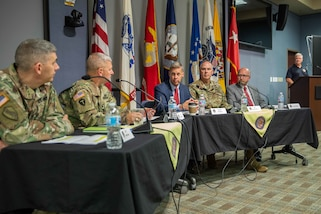 Federal Emergency Management Agency (FEMA) Director of Operations Division U.S. Army Maj. Gen. (ret) William Roy, who also served as the Joint Task Force Civil Support (JTF-CS) commanding general from July 2014 to July 2016, speaks as part of a leadership panel during a Defense Chemical, Biological, Radiological and Nuclear (CBRN) Response Force (DRCF) leadership symposium. The symposium was held during JTF-CS's 20th anniversary celebration, which also included a room dedication for the late U.S. Army Maj. Gen. (ret) Jeff Mathis III, who served as the command's commanding general from July 2012 to July 2014. The celebration was attended by representatives from U.S. Northern Command (NORTHCOM) and U.S. Army North (ARNORTH), DCRF unit commanders and FEMA regional leaders, as well as prior JTF-CS members and alumni. (Official DoD photo by Mass Communication Specialist 3rd Class Michael Redd/RELEASED)