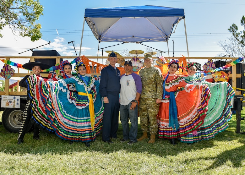 Performers at the Hispanic Heritage Month festival pose for a photo with service members from Team Kirtland at Kirtland Air Force Base, N.M., Oct. 3, 2019. The festival featured live music, folkloric dance, food trucks, information booths, key note speakers and a car show. (U.S. Air Force photo by Airman 1st Class Austin J. Prisbrey)