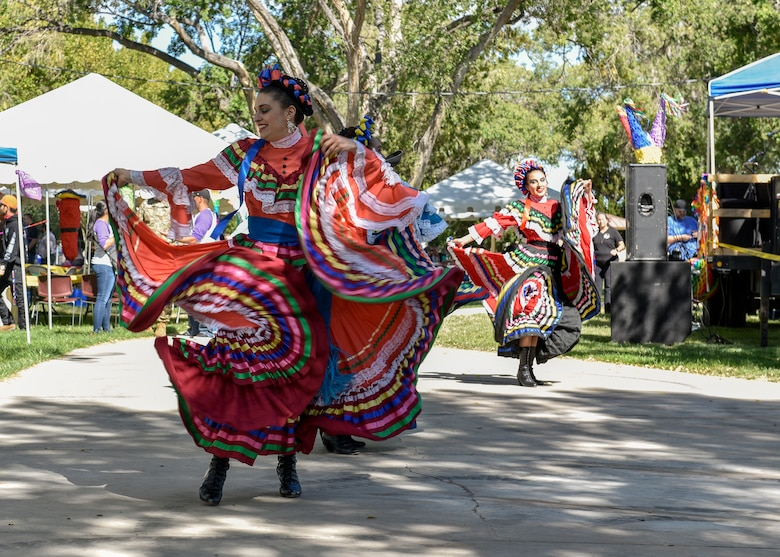 Dancers at the Hispanic Heritage Month festival perform a folkloric dance at Kirtland Air Force Base, N.M., Oct. 3, 2019. People belonging to the various units on base and mission partners of Kirtland AFB attended the festivities. (U.S. Air Force photo by Airman 1st Class Austin J. Prisbrey)