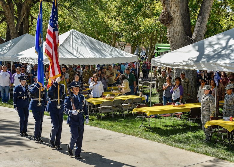 Members of the Kirtland Air Force Base Honor Guard present the colors at the Hispanic Heritage Month festival at Kirtland Air Force Base, N.M., Oct. 3, 2019. The festival featured live music, folkloric dance, food trucks, information booths, key note speakers and a car show. (U.S. Air Force photo by Airman 1st Class Austin J. Prisbrey)