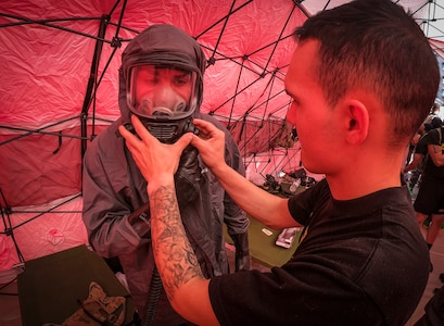 An Army Reserve Soldier from the 413th Chemical Company, 457th Chemical Battalion, 415th Chemical Brigade, 76th Operational Response Command checks the chemical protective mask of a fellow Soldier before he begins conducting a mass casualty decontamination training event at the Jacobi Medical Center, Bronx, New York, September 28. The event, which involved nearly 150 Army Reserve Soldiers, was part of a two-day consequence management training exercise focused on mass casualty decontamination, Chemical, Biological, Radiological and Nuclear (CBRN) reconnaissance and medical operations along side multiple civilian agencies in and around New York City. The training involved various scenarios including rescuing patients from a Subway disaster and decontamination operations at a local hospital. (Official U.S. Army Reserve photo by Sgt. 1st Class Brent C. Powell)