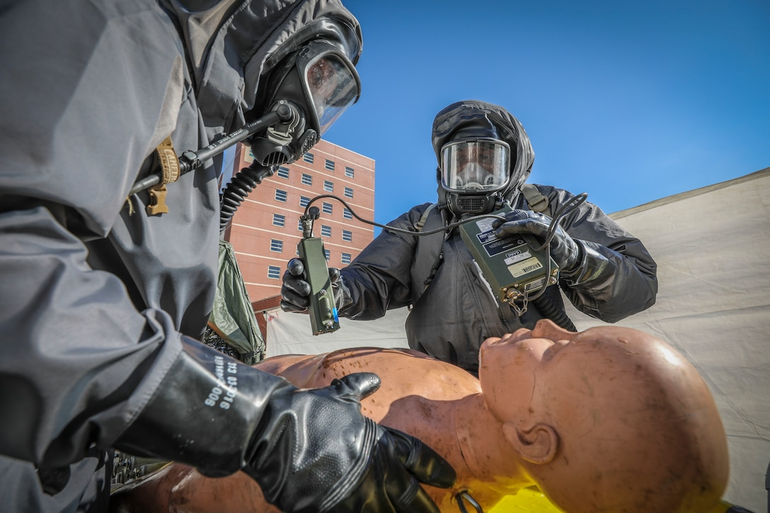 """Army Reserve Soldiers from the 413th Chemical Company, 457th Chemical Battalion, 415th Chemical Battalion, 76th Operational Response Command check a """"patient"""" for contamination during mass casualty decontamination training at the Jacobi Medical Center, Sept. 28, Bronx, New York. The event was part of a two-day consequence management training exercise focused on mass casualty decontamination, Chemical, Biological, Radiological and Nuclear (CBRN) reconnaissance and medical operations along side multiple civilian agencies in and around New York City. The training involved various scenarios including rescuing patients from a Subway disaster and decontamination operations at a local hospital. (Official U.S. Army Reserve photo by Sgt. 1st Class Brent C. Powell)"""