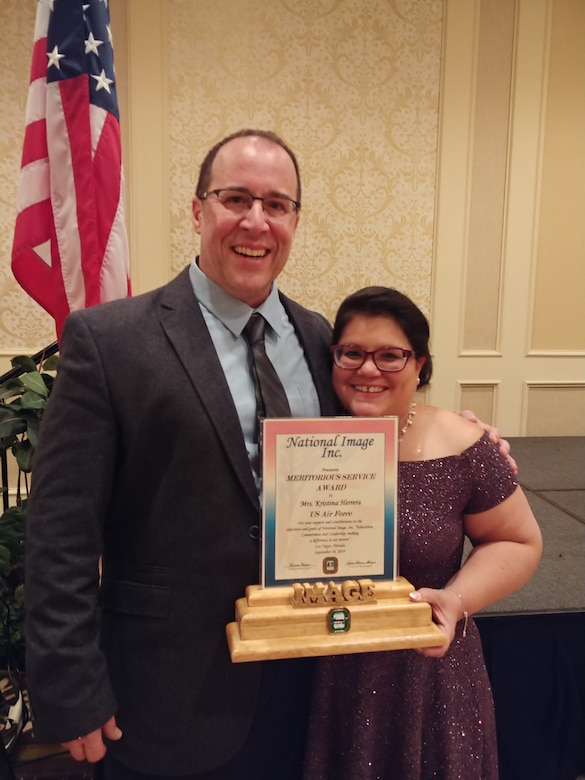 Kristine Herrera poses with her spouse, retired Air Force Master Sgt. Gustavo Herrera, shortly after receiving the National Image Inc. 2019 Meritorious Service Award . (Photo courtesy of Kristine Herrera)