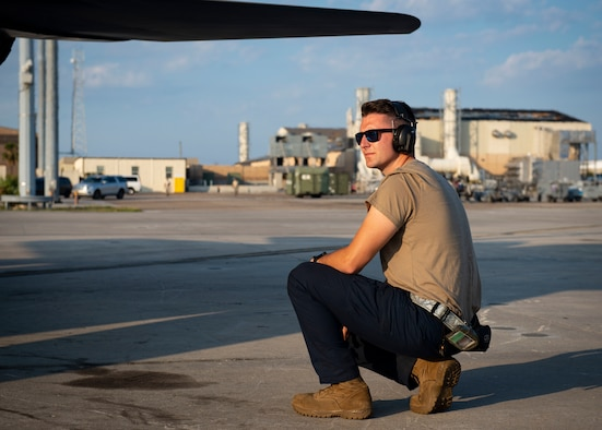 Senior Airman Caleb Crook, an aircraft electrical and environmental systems specialist assigned to the 757th Aircraft Maintenance Squadron, assists an aircraft launch during Combat Archer 19-12 at Tyndall Air Force Base, Fla., Sept. 24, 2019. The F-15E Strike Eagle fighter jet has the capability to fight its way to a target over long ranges, destroy enemy ground positions and fight its way out. (U.S. Air Force photo illustration by Airman 1st Class Bailee A. Darbasie)