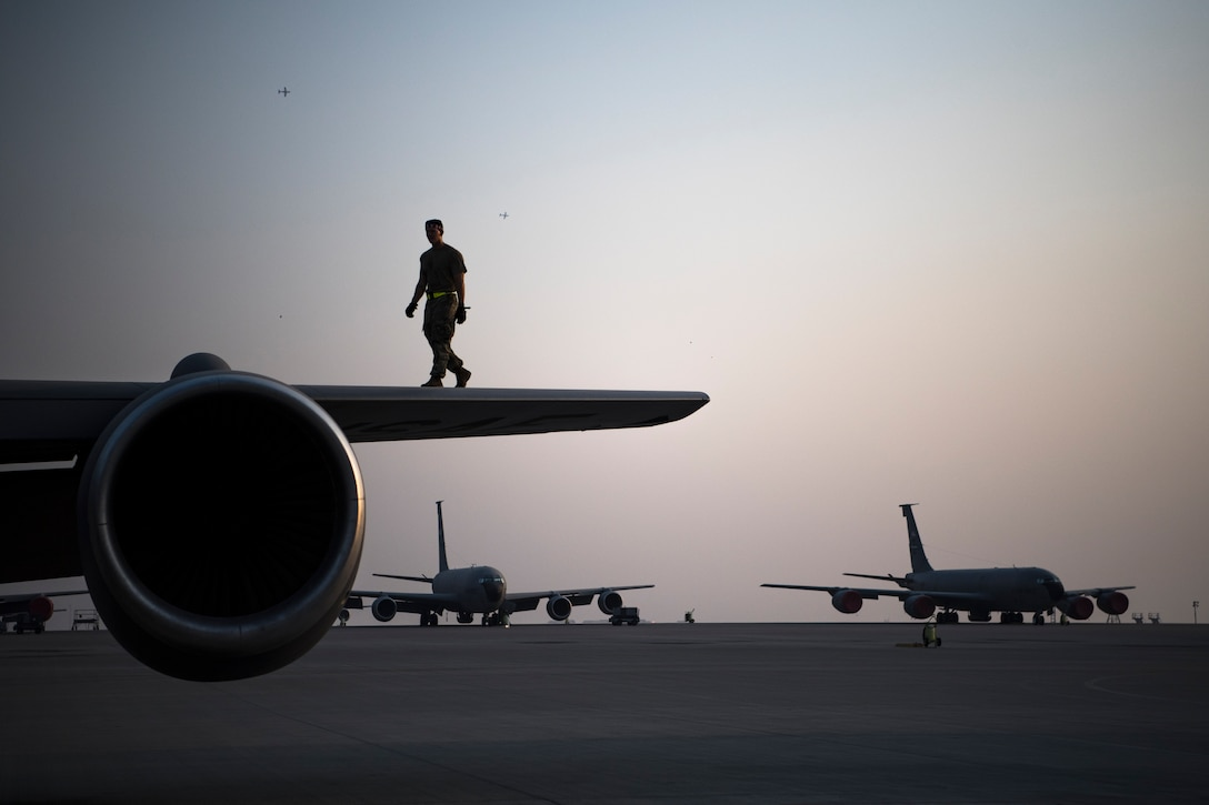 Airman performs post-flight inspections on a KC-135 Stratotanker
