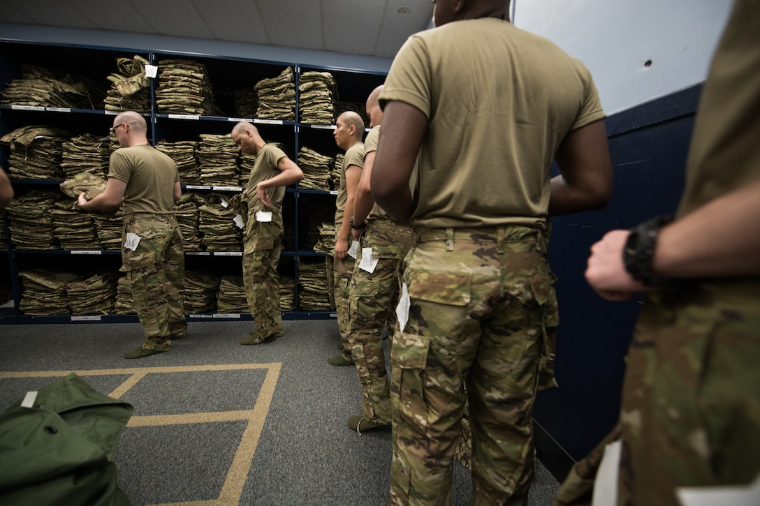 Basic military training trainees receive the first operational camouflage pattern uniforms