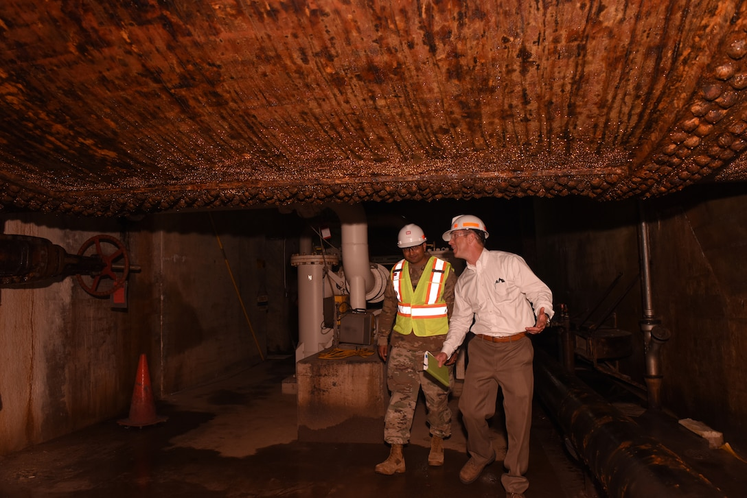 Lt. Col. Sonny B. Avichal, U.S. Army Corps of Engineers Nashville District commander, shows Joseph M. Savage, USACE Great Lakes and Ohio River Division Regional Business director, a hydropower penstock during a tour of the Center Hill Dam Power Plant in Lancaster, Tenn., Oct. 2, 2019. (USACE photo by Lee Roberts)