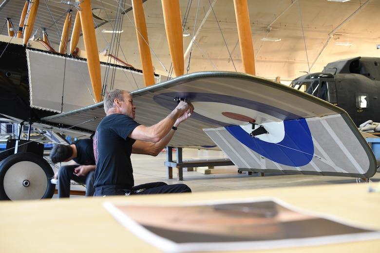 Biplane lower left wing work during restoration.