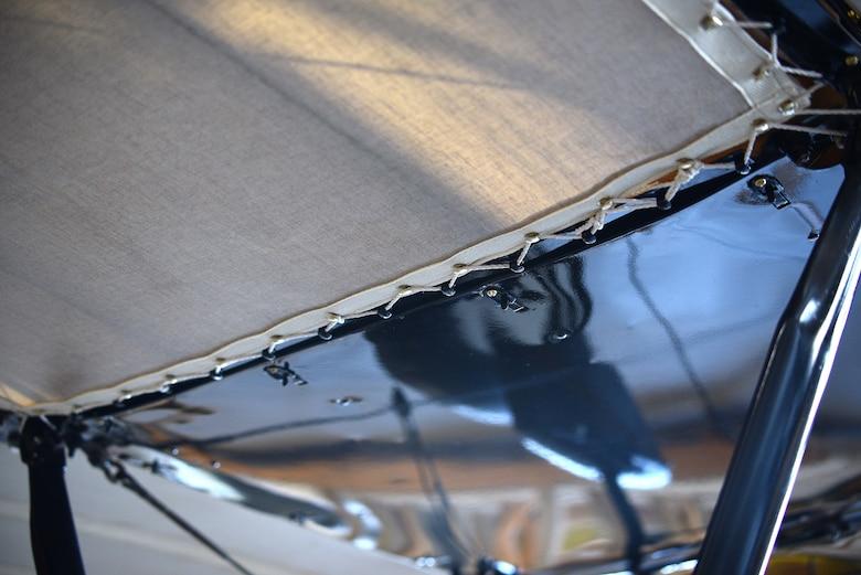 Underside view of biplane rib stitching during restoration.