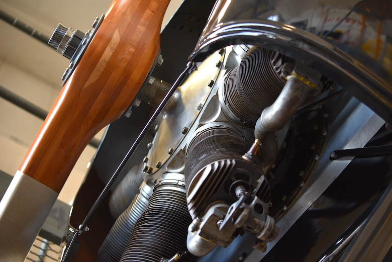 View of biplane engine and propeller during restoration.