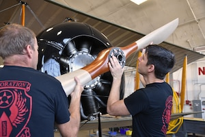 Propeller of a biplane being installed during restoration.