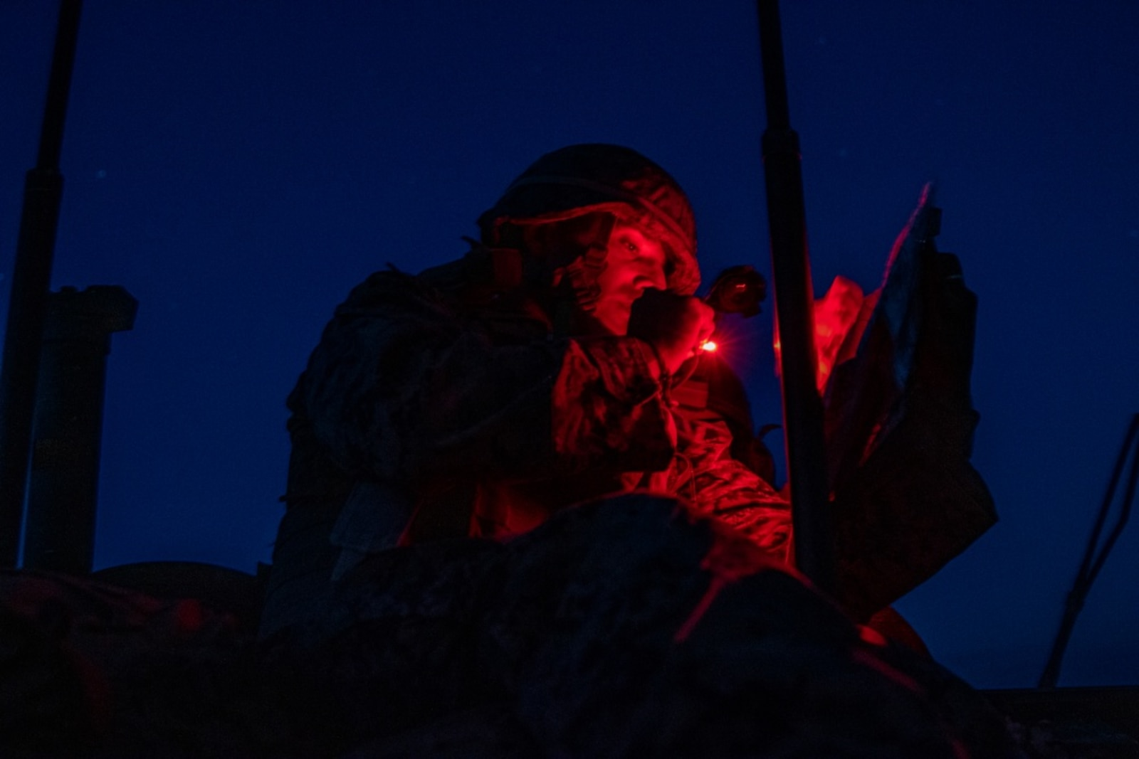 U.S. Marine Corps Staff Sgt. Marcos Luna, an exercise evaluator with 3rd Light Armored Reconnaissance Battalion, 1st Marine Division, looks at a map during a Marine Corps Combat Readiness Evaluation (MCCRE) at Marine Corps Air Ground Combat Center Twentynine Palms, California, Sept. 6, 2019. The MCCRE is used to formally evaluate Marines on their combat readiness prior to their upcoming deployment. (U.S. Marine Corps photo by Lance Cpl. Roxanna Ortiz)