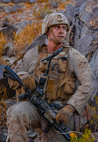U.S. Marine Corps Lance Cpl. Trevor Kunz, a team leader with 3rd Light Armored Reconnaissance Battalion, 1st Marine Division, scans the surrounding area during a Marine Corps Combat Readiness Evaluation (MCCRE) at Marine Corps Air Ground Combat Center Twentynine Palms, California, Sept. 7, 2019. The MCCRE is used to formally evaluate Marines on their combat readiness prior to their upcoming deployment. (U.S. Marine Corps photo by Lance Cpl. Roxanna Ortiz)