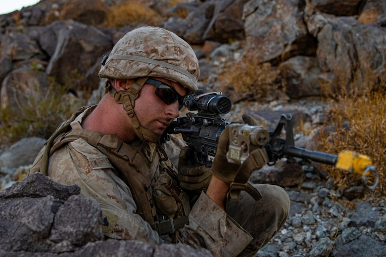 U.S. Marine Corps Cpl. Johnathan Wright, a mechanic with 3rd Light Armored Reconnaissance Battalion, 1st Marine Division, scans the surrounding area during a Marine Corps Combat Readiness Evaluation (MCCRE) at Marine Corps Air Ground Combat Center Twentynine Palms, California, Sept. 7, 2019. The MCCRE is used to formally evaluate Marines on their combat readiness prior to their upcoming deployment. (U.S. Marine Corps photo by Lance Cpl. Roxanna Ortiz)