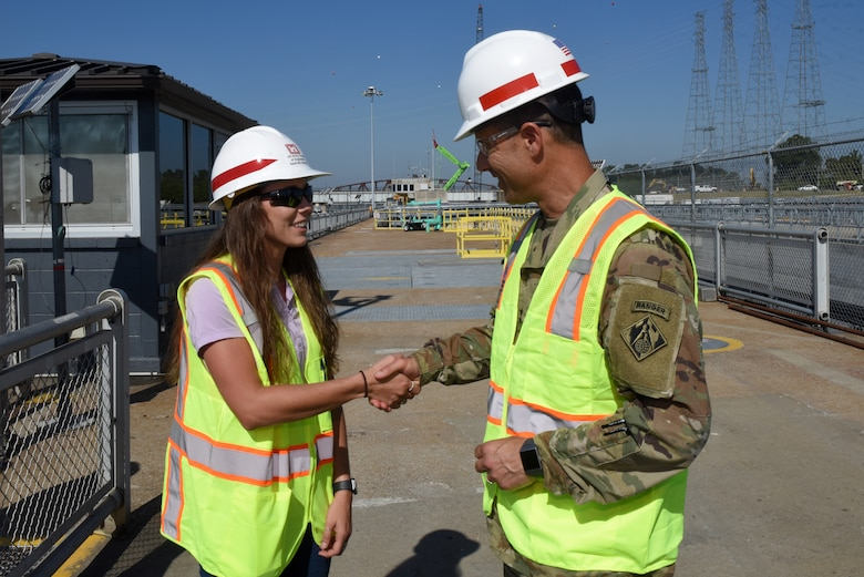 Maj. Gen. Robert F. Whittle, U.S. Army Corps of Engineers Great Lakes and Ohio River Division commanding general, recognizes Alex Carr, mechanical engineer at the Western Kentucky Resident Office, for excellence during a visit to Kentucky Lock and Kentucky Lock Addition Project in Grand Rivers, Ky., Oct. 3, 2019. The general recognized a number of Nashville District employees during his three-day visit to the district's area of operations. (USACE photo by Lee Roberts)