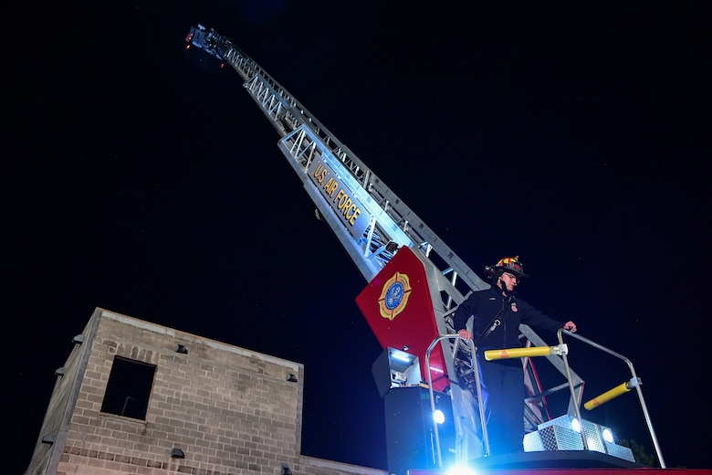 A base firefighter showcases the capability of the department's new, 100-foot ladder truck during a training demonstration Oct. 1, 2019, at Hill Air Force Base, Utah. Hill AFB's Fire and Emergency Services acquired the truck this summer to replace the department's 16-year-old truck. (U.S. Air Force photo by R. Nial Bradshaw)