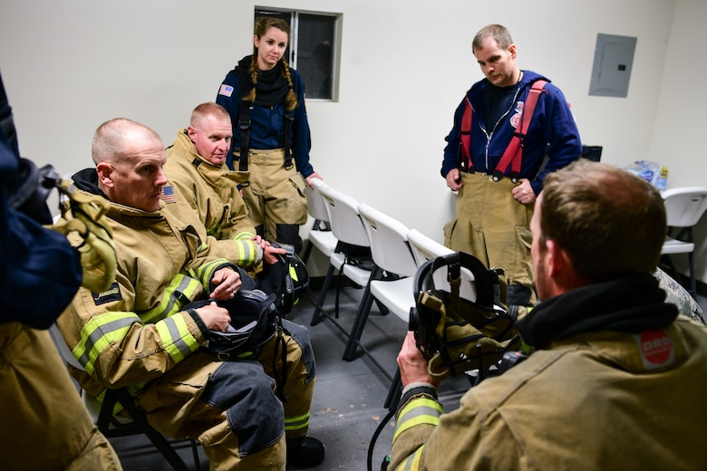 (Far left, left to right) Chief Master Sgt. Christopher Walker, 75th Air Base Wing command chief, and Col. Jon Eberlan, 75th ABW commander, during a safety briefing with base firefighters Oct. 1, 2019, at Hill Air Force Base, Utah. Walker and Eberlan took part in a Hill AFB Fire and Emergency Services training demonstration showcasing the capability a new, 100-foot ladder truck the department acquired this summer. (U.S. Air Force photo by R. Nial Bradshaw)
