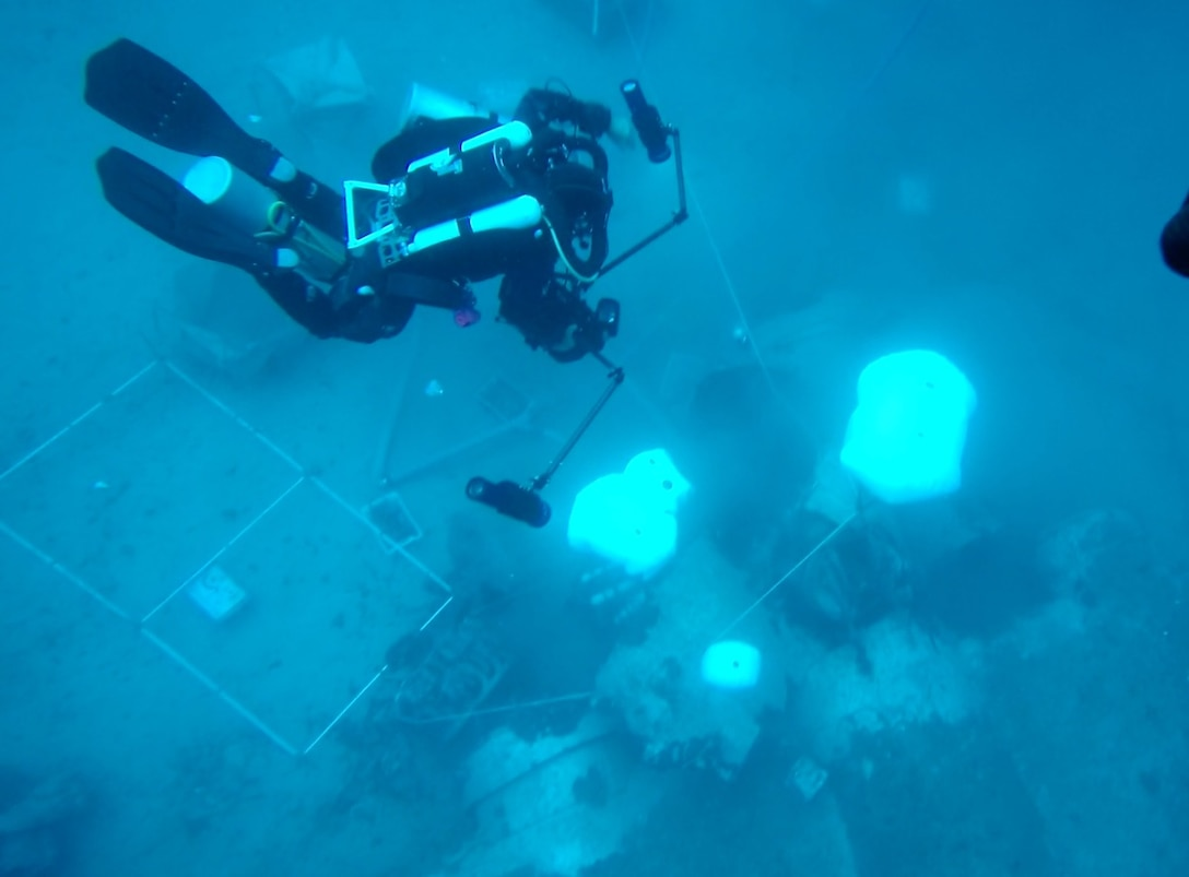 A diver from the University of Malta conducts underwater recovery operations on a B-24 aircraft site from World War II offshore of Marsaxlokk, Republic of Malta in July, 2019. Photo courtesy of the University of Malta.