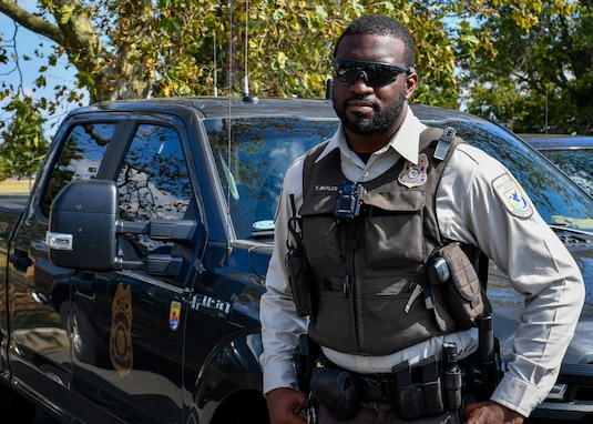 Terrance Butler, United States Fish & Wildlife Service federal Wildlife officer, poses in front of his work vehicle on Joint Base McGuire-Dix-Lakehurst, New Jersey, Oct. 2, 2019. Butler is the first USFWS officer assigned to Joint Base MDL where he will support the mission of the base in conjunction with assisting the conservation program that includes hunting, fishing and environmental issues.