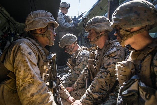 U.S. Marines and a U.S. Navy Corpsman with 1st Battalion, 5th Marine Regiment, participate in a simulated casualty evacuation during the Marine Corps Combat Readiness Evaluation (MCCRE) on Marine Corps Base Camp Pendleton, California, Sept. 18, 2019. 5th Marines conducted a regimental-sized MCCRE that included 1st Battalion, 5th Marines, 2nd Battalion, 5th Marines, and the Regimental Headquarters to increase the combat proficiency and readiness of the regiment. The MCCRE took place over a 10-day period and served as a proof of concept for future regimental-sized MCCREs. (U.S. Marine Corps photo by Lance Cpl. Alexa M. Hernandez)