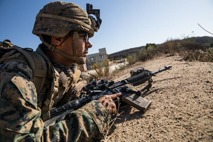 U.S. Navy HM3 Ruben De La Torre, a corpsman with 1st Battalion, 5th Marine Regiment, 1st Marine Division, posts security during the Marine Corps Combat Readiness Evaluation (MCCRE) on Marine Corps Base Camp Pendleton, California, Sept. 21, 2019. 5th Marines conducted a regimental-sized MCCRE that included 1st Battalion, 5th Marines, 2nd Battalion, 5th Marines, and the Regimental Headquarters to increase the combat proficiency and readiness of the regiment. The MCCRE took place over a 10-day period and served as a proof of concept for future regimental-sized MCCREs. (U.S. Marine Corps photo by Lance Cpl. Alexa M. Hernandez)