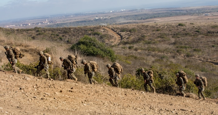 U.S. Marines with Charlie Company, 1st Battalion, 5th Marine Regiment, 1st Marine Division, hike up a hill during the Marine Corps Combat Readiness Evaluation (MCCRE) on Marine Corps Base Camp Pendleton, California, Sept. 23, 2019. 5th Marines conducted a regimental-sized MCCRE for 1st Battalion, 5th Marines and 2nd Battalion, 5th Marines, as well as the Regimental Headquarters to increase the combat proficiency and readiness of the regiment. The MCCRE took place over a 10 day period and served as proof of concept for future regimental-sized MCCREs. (U.S. Marine Corps photo by Lance Cpl. Alexa M. Hernandez)