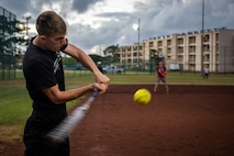 U.S. Marine Corps Lance Cpl. Jordan Dunn, a food service specialist with Headquarters Battalion (HQBN), Marine Corps Base Hawaii (MCBH), swings a bat during a game of softball, MCBH, Oct. 2, 2019. U.S. Marines with HQBN and Combat Logistics Battalion 3 competed in a game of softball to boost morale and camaraderie amongst their Marines. (U.S. Marine Corps photo by Cpl. Matthew Kirk)