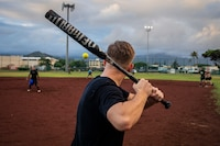 U.S. Marine Corps Cpl. Kirkland Wolfe, a supply administration and operations specialist with Headquarters Battalion (HQBN), Marine Corps Base Hawaii (MCBH), prepares to swing a bat during a game of softball, MCBH, Oct. 2, 2019. U.S. Marines with HQBN and CLB-3 competed in a game of softball to boost morale and camaraderie amongst their Marines. (U.S. Marine Corps photo by Cpl. Matthew Kirk)