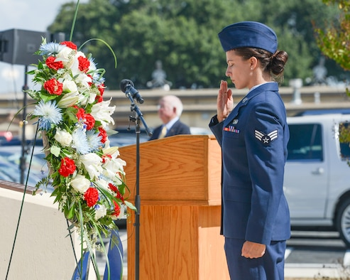 A U.S. Air Force Airman with the Twenty-Fifth Air Force salutes a wreath laid in tribute during the annual headquarters remembrance ceremony at Joint Base San Antonio-Lackland, Texas, Oct. 4, 2019. More than 5,600 of the community's brothers and sisters have perished, and the names of more than 130 of the most recent losses were read during the ceremony. (U.S. Air Force photo by Sharon Singleton)