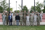 Delegates from Colorado's state partners, Jordan and Slovenia, stand for a photo with Maj. Gen. Mike Loh, the adjutant general of Colorado, center, and other