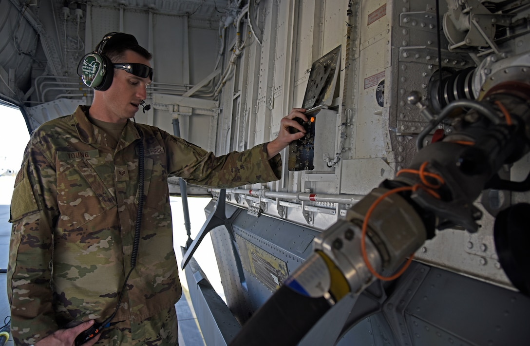 U.S. Air Force Senior Airman Eli Young, 92nd Aircraft Maintenance Squadron flying crew chief, checks fuel gauge on the KC-135 Stratotanker at Royal Australian Air Force Amberley, Australia, Sept. 15, 2019. The Air Operations Center has nine directorates and one squadron dedicated to help plan, task, execute and assess all Mobility Air Force missions around the globe. (U.S. Air Force photo by Senior Airman Jesenia Landaverde)