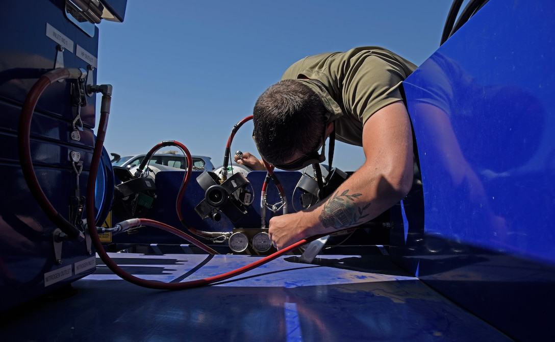 U.S. Air Force Staff Sgt. Robert Hunter, 92nd Aircraft Maintenance Squadron flying crew chief, checks nitrogen pressurization at Royal Australian Air Force Amberley, Australia, Sept. 15, 2019. Air Mobility Command averages one aircraft departure every 2.9 minutes, and the 618th Air Operations Center executes command and control over 200 of those sorties every day. (U.S. Air Force photo by Senior Airman Jesenia Landaverde)