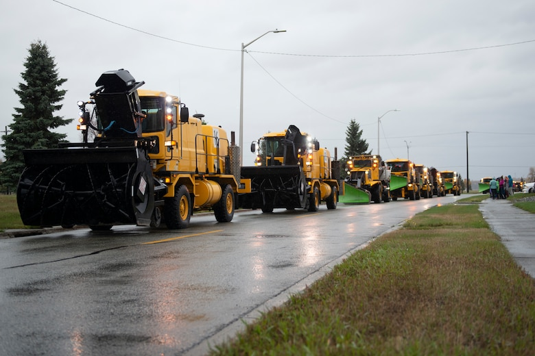 A member of the 773d Civil Engineering Squadron operates snow removal equipment during the annual Snow & Ice Parade on Joint Base Elmendorf-Richardson, Alaska, Oct. 4, 2019. The parade showcased the snow-removal vehicles snow barn personnel use to keep the airfield operational and the roads cleared.