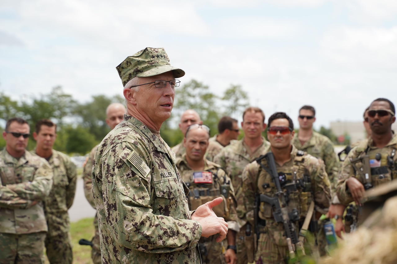 Navy Adm. Craig Faller, commander of U.S. Southern Command, talks with soldiers.