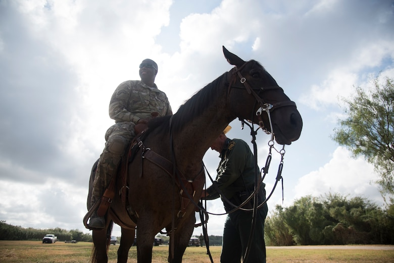 "Command Chief Master Sgt. Robert Zackery III, 47th Flying Training Wing command chief saddles up during the Del Rio Border Patrol Sector immersion tour Oct. 4, 2019 in Del Rio, Texas. ""Interagency cooperation is super important,"" Zackery said. ""One of the elements of power is the military, so understanding the other agencies such as the Department of State, the Department of Homeland Security, is vital to our national security."" (U.S. Air Force photo by Staff Sgt. Benjamin N. Valmoja"