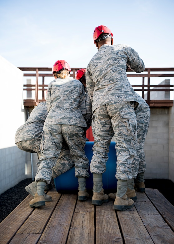 U.S. Air Force Airmen from the 366th Fighter Wing attempt to complete an obstacle September 30, 2019, at the Leadership Reaction Course (LRC) on Gowen Field, Idado. The LRC is used to develop leadership and followership skills through overcoming obstacles with limited resources while giving participants a chance to adapt and overcome through teamwork. (U.S. Air Force photo by Airman 1st Class Andrew Kobialka)
