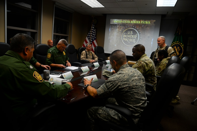 Col. Lee Gentile, 47th Flying Training Wing commander, and Command Chief Robert Zackery III, 47th FTW command chief, are briefed by Del Rio Border Patrol Sector officals Oct. 4, 2019, in Del Rio, Texas. Laughlin leadeship was invited on tour with Del Rio Border Patrol Sector to get a firsthand look at Border Patrol operations as well as strengthening community bonds. (U.S. Air Force photo by Senior Airman Marco A. Gomez)