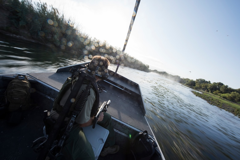 An agent with the U.S. Border Patrol sits in a diamondback air boat Oct. 4, 2019 in Del Rio, Texas. Laughlin leadeship was invited on tour with Del Rio Border Patrol Sector to get a firsthand look at Border Patrol operations as well as strengthening community bonds. (U.S. Air Force photo by Senior Airman Marco A. Gomez)