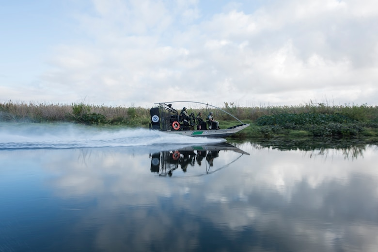 The U.S. Border Patrol tour group rides in a diamondback air boat Oct. 4, 2019 in Del Rio, Texas. The command team got a tour with Del Rio Border Patrol Sector on the Rio Grande river, which marks a portion of the international border between the U.S. and Mexico. (U.S. Air Force photo by Senior Airman Marco A. Gomez)