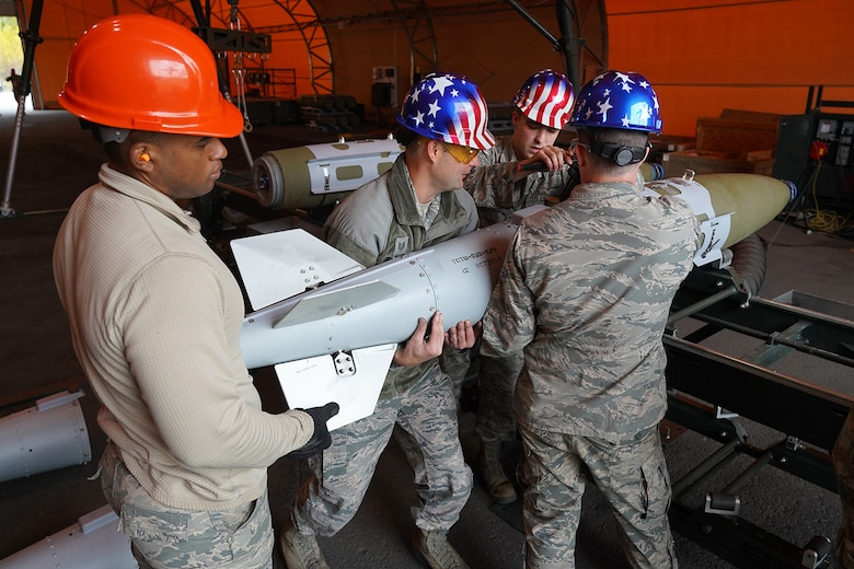 Airmen assigned to the 3rd Munitions Squadron build GBU-32s (Guided Bomb Units) on Joint Base Elmendorf-Richardson, Alaska, Oct. 2, 2019, while participating in the Polar Force 20-1 exercise. Polar Force 20-1 is designed to exercise multiple elements of the Agile Combat Employment (ACE) concept of operations, which include generating 5th Generation combat power from austere locations, command and control using non-traditional methods, and rapid airlift capabilities to sustain a forward operating location.  The ACE concept enables 3rd Wing to deliver lethal Airpower for America, even in a contested environment.