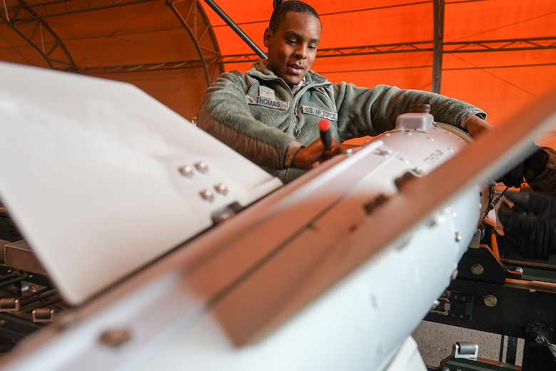Airman Nathan Thomas, a native of Waco, Texas, assigned to the 3rd Munitions Squadron helps build a GBU-32 (Guided Bomb Unit) on Joint Base Elmendorf-Richardson, Alaska, Oct. 2, 2019, while participating in the Polar Force 20-1 exercise. Polar Force 20-1 is designed to exercise multiple elements of the Agile Combat Employment (ACE) concept of operations, which include generating 5th Generation combat power from austere locations, command and control using non-traditional methods, and rapid airlift capabilities to sustain a forward operating location.  The ACE concept enables 3rd Wing to deliver lethal Airpower for America, even in a contested environment.