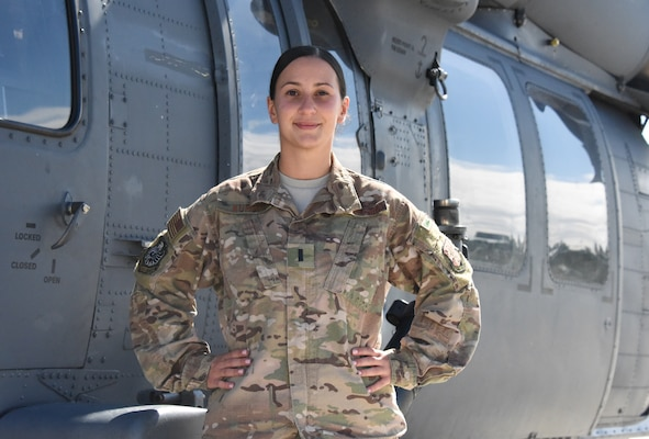 U.S. Air Force 1st Lt. Julie Kurdi, a maintenance officer assigned to the 106th Rescue Wing, New York Air National Guard, pose for a photo on the flight line at Francis S. Gabreski Air National Guard Base, Westhampton Beach, New York, Sept. 7, 2019. Kurdi spent 17 years enlisted in Security Forces before she commissioned in 2017. (U.S. Air National Guard photo by Airman 1st Class Kevin J. Donaldson)