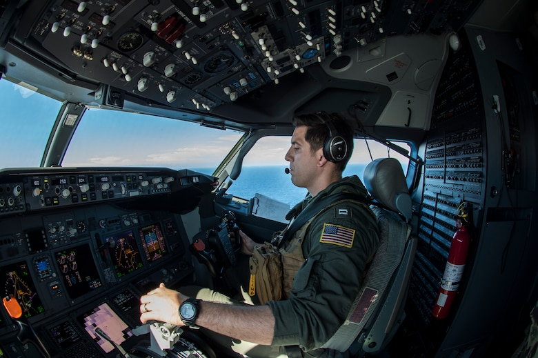 """PACIFIC OCEAN (Oct.04, 2019) Lt. Brandon Swindler pilots a U.S. Navy P-8A Poseidon aircraft assigned to the """"Mad Foxes"""" of Patrol Squadron (VP) 5. The VP-5 detachment participated in exercise Malabar 2019, and is conducting maritime patrol and reconnaissance as well as theater outreach operations within U.S. 7th Fleet area of operations."""