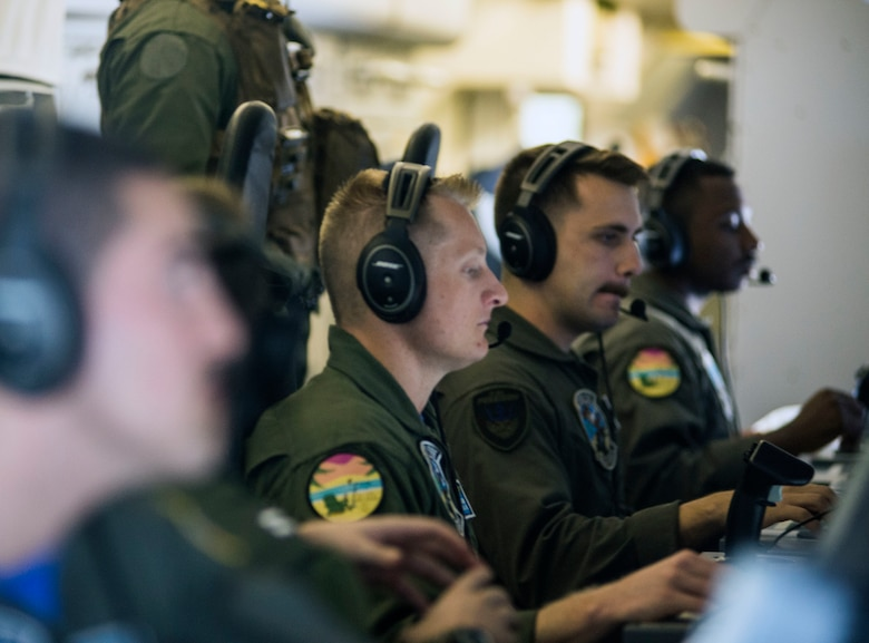 """PACIFIC OCEAN (Oct.04, 2019) Aircrew assigned to the """"Mad Foxes"""" of Patrol Squadron (VP) 5, operate mission control workstations aboard a U.S. Navy P-8A Poseidon aircraft . The VP-5 detachment participated in exercise Malabar 2019, and is conducting maritime patrol and reconnaissance as well as theater outreach operations within U.S. 7th Fleet area of operations."""