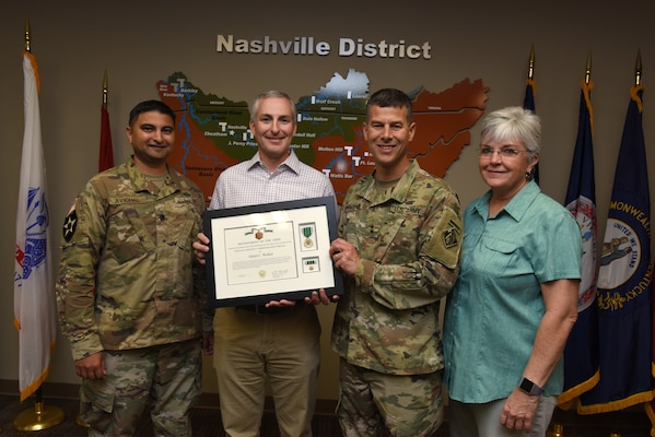 (Left to right) Lt. Col. Sonny B. Avichal, U.S. Army Corps of Engineers Nashville District commander; Adam Walker, Chickamauga Lock Replacement Project manager; Maj. Gen. Robert F. Whittle Jr., USACE Great Lakes and Ohio River Division commanding general; and Patty Coffey, Nashville District deputy district engineer; pose during an award ceremony Oct. 2, 2019 at the Nashville District Headquarters in Nashville, Tenn. Whittle presented Walker with the U.S. Army Civilian Service Commendation Medal for managing the Joint Risk Register Pilot Program, an effort to reduce safety risk and identify opportunities for improvement. (USACE photo by Lee Roberts)