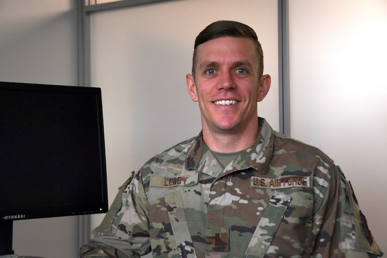 U.S. Air Force 2nd Lt. Zachary Leddy, 145th Airlift Wing Contracting officer, posed for a picture at his desk after discussing his involvement in the year end fiscal purchases with unexpected funding at the North Carolina Air National Guard (NCANG) Base, Charlotte Douglas International Airport, Oct. 4th, 2019. Members from the 145th Airlift Wing Contracting office, Finance, and Logistics Readiness Squadron collaborated across the wing to ensure end of year funds were appropriately spent on equipment needed for readiness for the 118th ASOS and 145th Airlift Wing. Members were able to purchase equipment for almost 1,500 members of the NCANG to ensure deployment readiness.