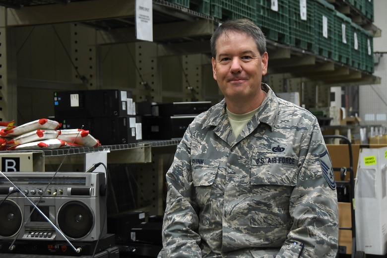 U.S. Air Force Master Sgt. James Guinn, 145th Airlift Wing Logistics Readiness Squadron, posed for a picture in the logistics warehouse after discussing his involvement in the year end fiscal purchases with unexpected funding at the North Carolina Air National Guard (NCANG) Base, Charlotte Douglas International Airport, Oct. 4th, 2019. Members from the 145th Airlift Wing Contracting office, Finance, and Logistics Readiness Squadron collaborated across the wing to ensure end of year funds were appropriately spent on equipment needed for readiness for the 118th ASOS and 145th Airlift Wing. Members were able to purchase equipment for almost 1,500 members of the NCANG to ensure deployment readiness.
