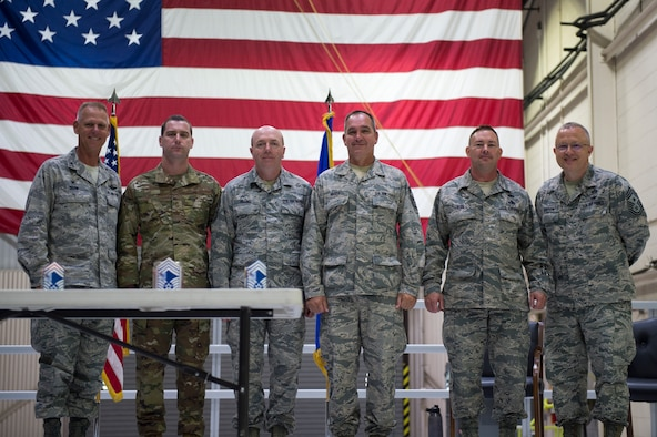 Col. Larry Shaw, 434th Air Refueling Wing commander left and Chief Master Sgt. Wes Marion, 434th Air Refueling Squadron command chief right pose with new chief master sergeants during an induction ceremony here Oct. 6, 2019. Chief Master Sgt. Adam Loos, 434th Civil Engineer Squadron, Chief Master Sgt. James Billing, 434th Maintenance Squadron, Chief Master Sgt. Charles Hoover, 434th Maintenance Group and Chief Master Sgt. Brian Rude, 434th Logistics Readiness Squadron. The new chiefs were among the 73 Airmen who were inducted into the ranks of noncommissioned officers and senior noncommissioned officers. (U.S. Air Force Photo/Tech. Sgt. Jami K. Lancette)