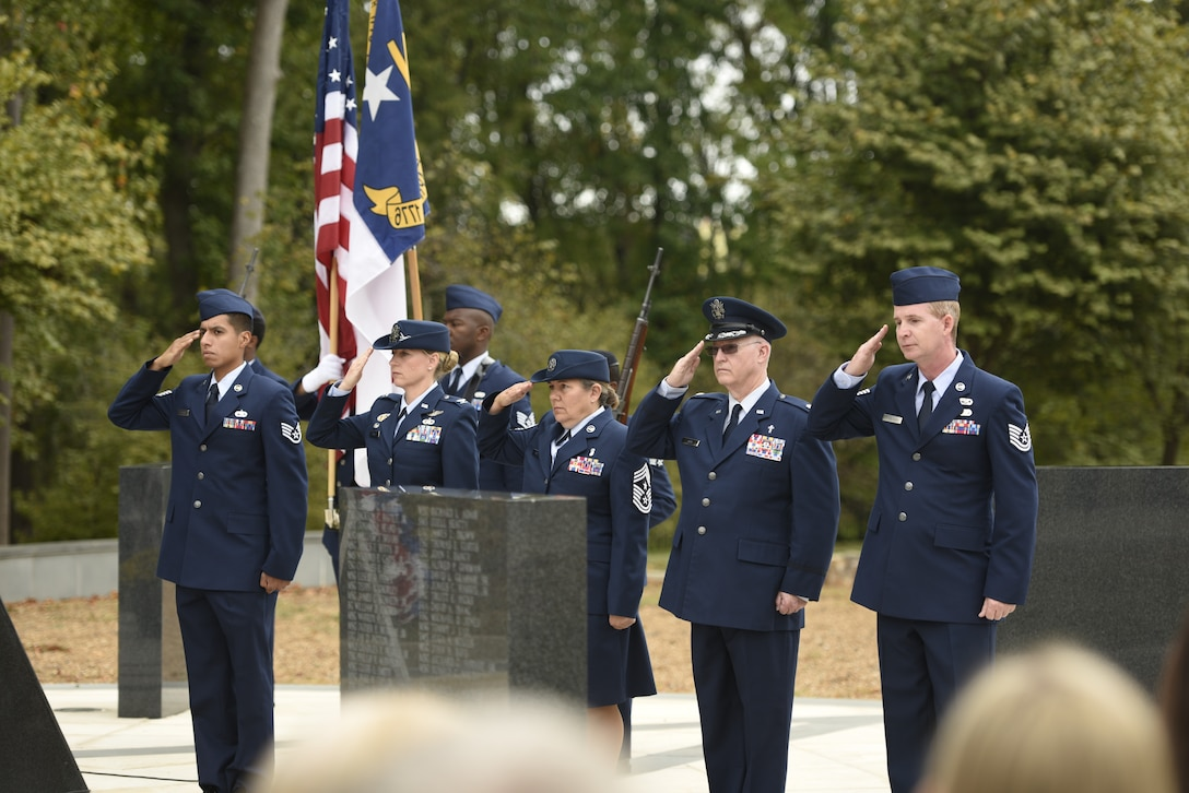 Members of the North Carolina Air National Guard render salutes to pay tribute to fallen Airmen during a Memorial Wall Dedication Ceremony held at the North Carolina Air National Guard Base, Charlotte Douglas International Airport, Oct. 6th, 2019. Memorial dedications provide an annual moment for pause to honor fallen Airmen.